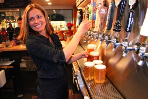 Bartender Jessica Krzygocki pours a few craft brews at The Commons on Broadway. (Daniel Archuleta daniela@smdp.com)