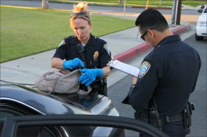 Santa Monica police search through the belongings found in a car that was involved in a persuit that led authorities through Venice and Santa Monica. Three suspects are said to be in custody with a fourth possibily at large in Venice. (Photo by Daniel Archuleta)
