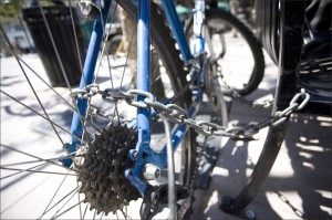 LOCKING IT UP: Santa Monica police recommend using a sturdy U-lock to secure bikes left unattended, not a chain like the one pictured. (File photo)