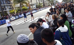 Crowds line Ocean Avenue last year to watch racers participate in the Los Angeles Marathon. (File photo)