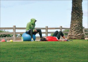 A trainer and his client workout in Palisades Park. (File photo)
