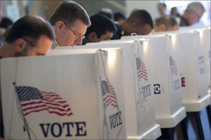 Voters cast ballots at City Hall during November's election. (File photo)