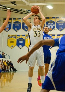 Samohi's Spencer Cramer attempts a shot against Culver City earlier this season. (Photo by Paul Alvarez Jr.)