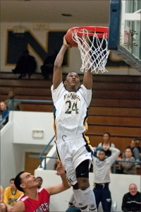 SKY: Santa Monica High School's Jordan Mathews rises up for a dunk against Morningside on Tuesday at home. Samohi won the game, 79-49. The win improves the Vikings to 8-1 in league. (Photo by Morgan Genser)