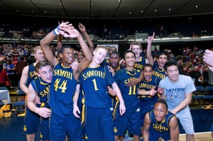 Samohi's boys' basketball team celebrates after winning the CIF-SS Division 1A title on Saturday at the Anaheim Convention Center. (Photo by Morgan Genser)