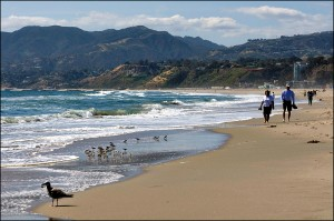 People walk along Santa Monica Beach. (File photo)
