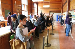 A line of people wait for service at the post office on Fifth Street on Tuesday. (Photo by Daniel Archuleta)