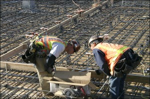 Workers prepare the foundation last year for a construction project on High Place. (File photo)