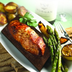 Seasons 52 chegs use ceder planks to help enhance the flavor of salmon without adding any additional calories to the dish. (Photo courtesy Seasons 52)