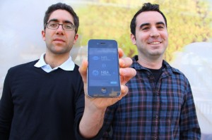 HIGH TECH: Joe Sarafian and David Rabie show off their Draftpedia app for the iPhone. (Photo by Daniel Archuleta)
