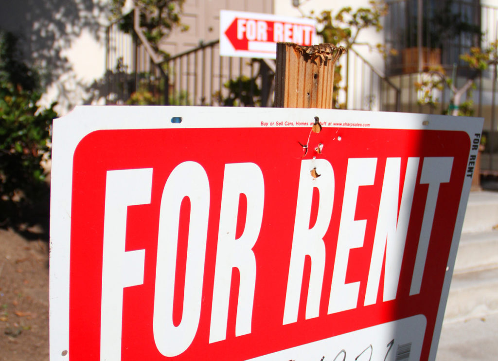 For rent signs sit in front of an apartment building on Fifth Street ...